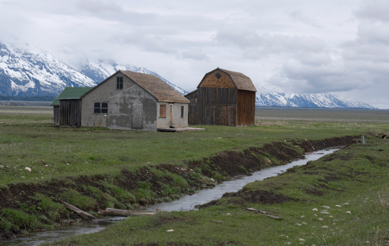 House and barn on Mormon row by Murray Fenner