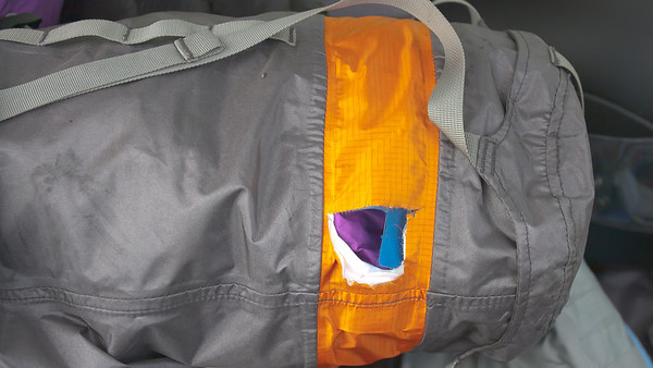 My sleeping bag jettisoned off my pannier in the left lane of I5 in downtown Seattle. Bad tie down. Secured the dry bag with gaffer's tape, and it stayed dry the entire trip.