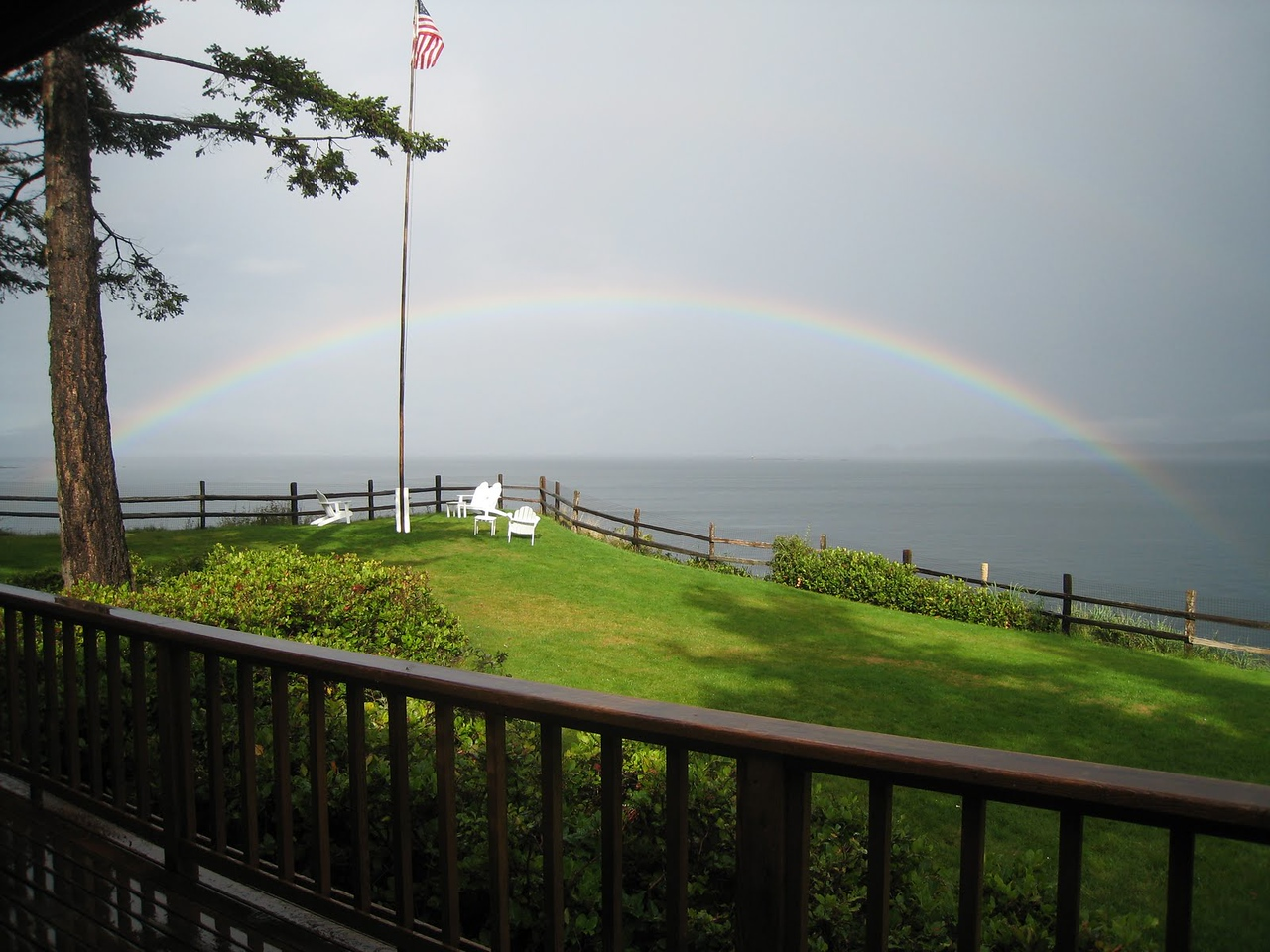 It was a rainy day, and this double rainbow formed across the back yard of the house - COOL!