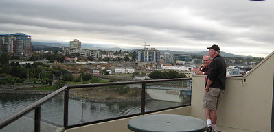 Here's Mike on the balcony talking with our friend Phil (Phil & Linda had the penthouse right next to ours).