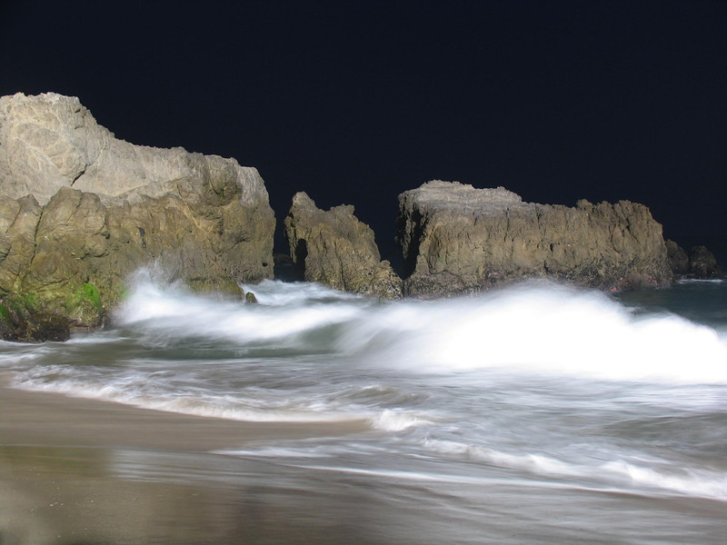 Waves Crashing ashore at Night