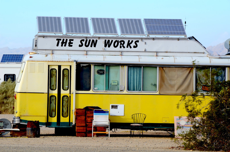"""In business at this location since 1986, The Sun Works run by Mike is a well know solar system provider. The day we stopped by he was busy adding a solar system to a sun blocker RV for a couple from Canada.<br /> <br /> For Mike's view about living in Slab City check out the following link:<br /> <br />  <a href=""""http://www.thesunworks.com/id55.htm"""">http://www.thesunworks.com/id55.htm</a>"""