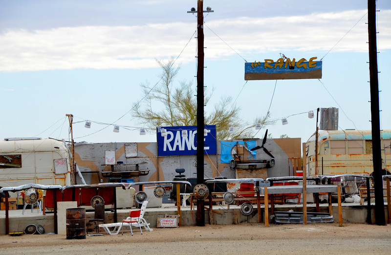 """Builder Bill has organized what he calls """"The Range"""" a stage with live entertainment by local entertainers each Saturday. The name comes from the nearby Naval artillery range where distant loud thumps are often heard.<br /> <br /> The Range at Slab City with Builder Bill:<br />  <a href=""""http://www.youtube.com/watch?v=rMnG-RhkNjc"""">http://www.youtube.com/watch?v=rMnG-RhkNjc</a>"""