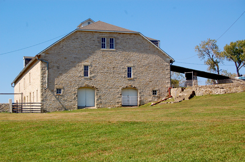 Tallgrass Prairie National Preserve<br /> <br /> Massive three story barn. Teams of horses with wagons could enter via the ramps shown in the photograph..