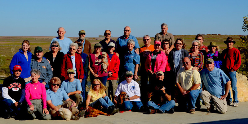 """Kansas Flint Hills Rally Group Picture<br /> <br /> A very diverse group of folks came from South Carolina, California, Arizona, Iowa, Missouri, Colorado, Texas, Kansas and Finland. Their enthusiasm in exploring the beautiful Flint Hills was much appreciated.<br /> <br /> Along the way, we had a lot of fun seeing old friends and meeting new ones while providing some much needed financial support to the local communities.<br /> <br /> A very special thanks to George Chaffee for his efforts putting together another award winning video of our event:<br />  <a href=""""http://www.youtube.com/watch?v=BcsG0HjhDhM"""">http://www.youtube.com/watch?v=BcsG0HjhDhM</a>"""