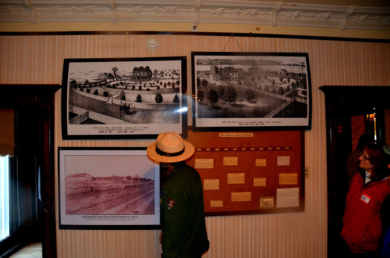 Tallgrass Prairie National Preserve<br /> <br /> N.P. Ranger points out old lithograph of the Spring Hil Ranch and a William Henry Jackson photo of the ranch it its early days.