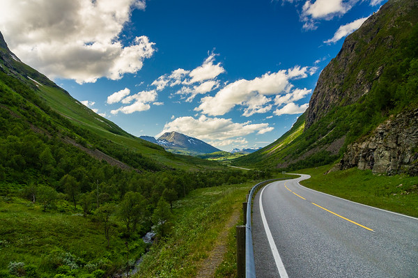 Curvy and lonely road between norwegian mountains
