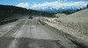 Common summer road, Wyoming. (Note the contrast of majestic Tetons and road construction.) 2011.