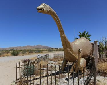 Golden dinosaurs along the highway in Twentynine Palms, California.