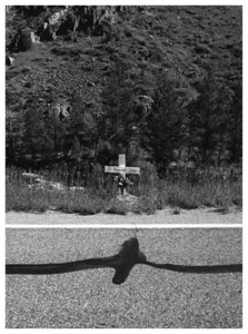 This memorial to Ed Hayward, made on the Cache la Poudre river is mirrored by the tar sealant on the road.