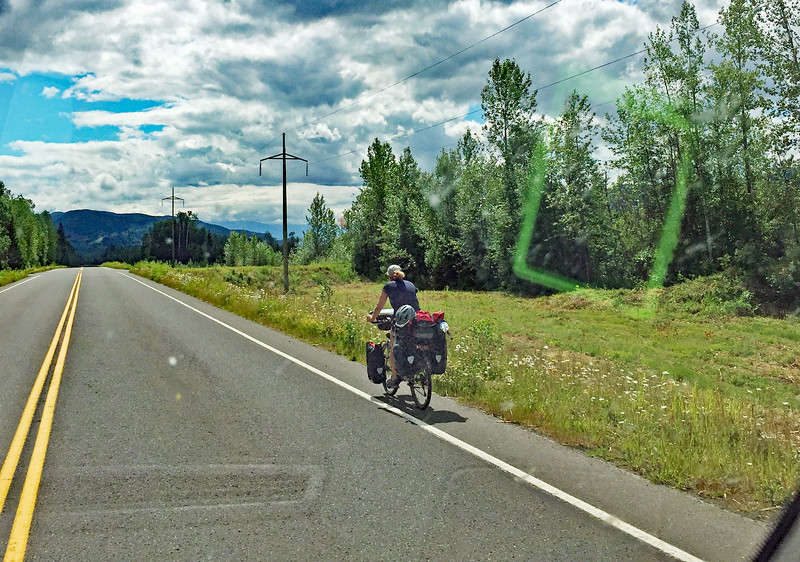 A lone rider on the Cassiar Highway