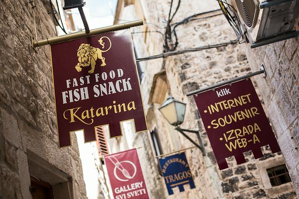 Hanging signs in Trogir, Croatia