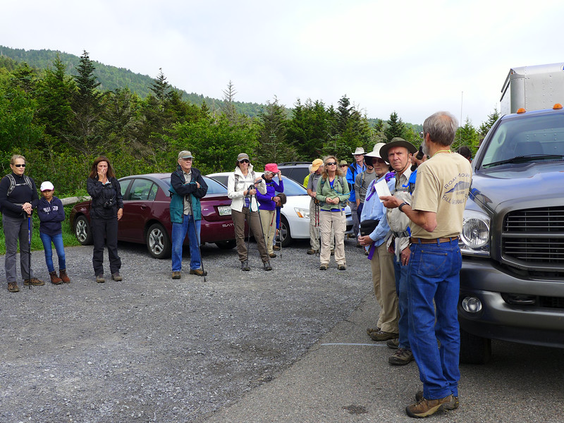 Todd (with back to the camera) giving instructions to the group of volunteers