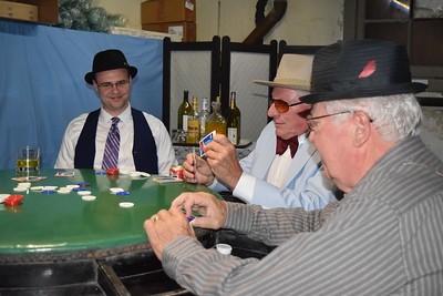 Men play poker in the old 'Happy Hour Club' in the basement of the Doherty Hotel.