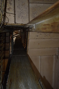 A look up the service stairs from the basement to upper floors.