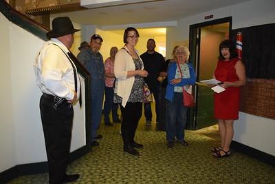 A group starts a basement tour during the Roaring Twenties Speakeasy fund raiser.
