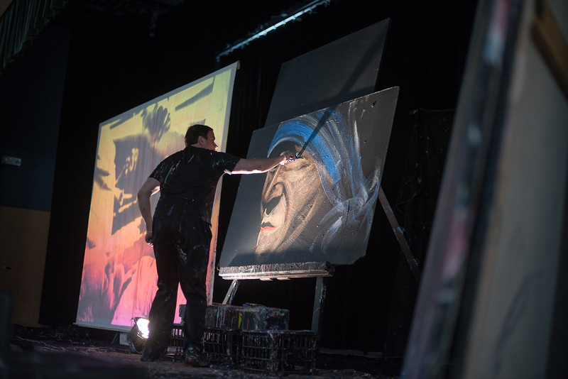 04/30/17 LEOMINSTER-- Famed artist and speed painter Rob Surette provides words of wisdom while speeding through a painting of Mother Teresa at the St Leo School in Leominster on Sunday April 30, 2017.  (Sentinel & Enterprise photo/Jeff Porter)