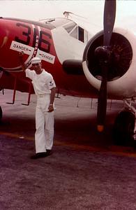 Unknown sailor standing next to SNB-5 Beechcraft Okinawa 1963