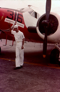 Unknown sailor standing next to SNB-5 Beechcraft Okinawa 1963
