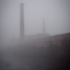 The thick fog around the Merrimack River made the smokestacks around the Lawrence Mills look like towering ghosts.