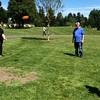 Grandma showing her frisbee skills