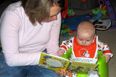 Mommy is reading a farm book to me
