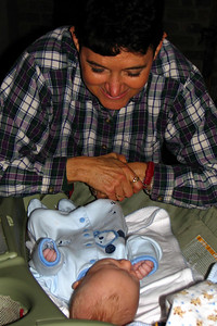 Grandma Helen playing with Zach after a diaper change