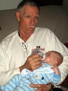 Grandpa Larry getting his turn feeding Zach