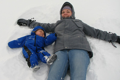 Making snow angels! Zach wasn't quite sure what to do