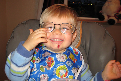 zach wants to try dadda's glasses...he is a mini me