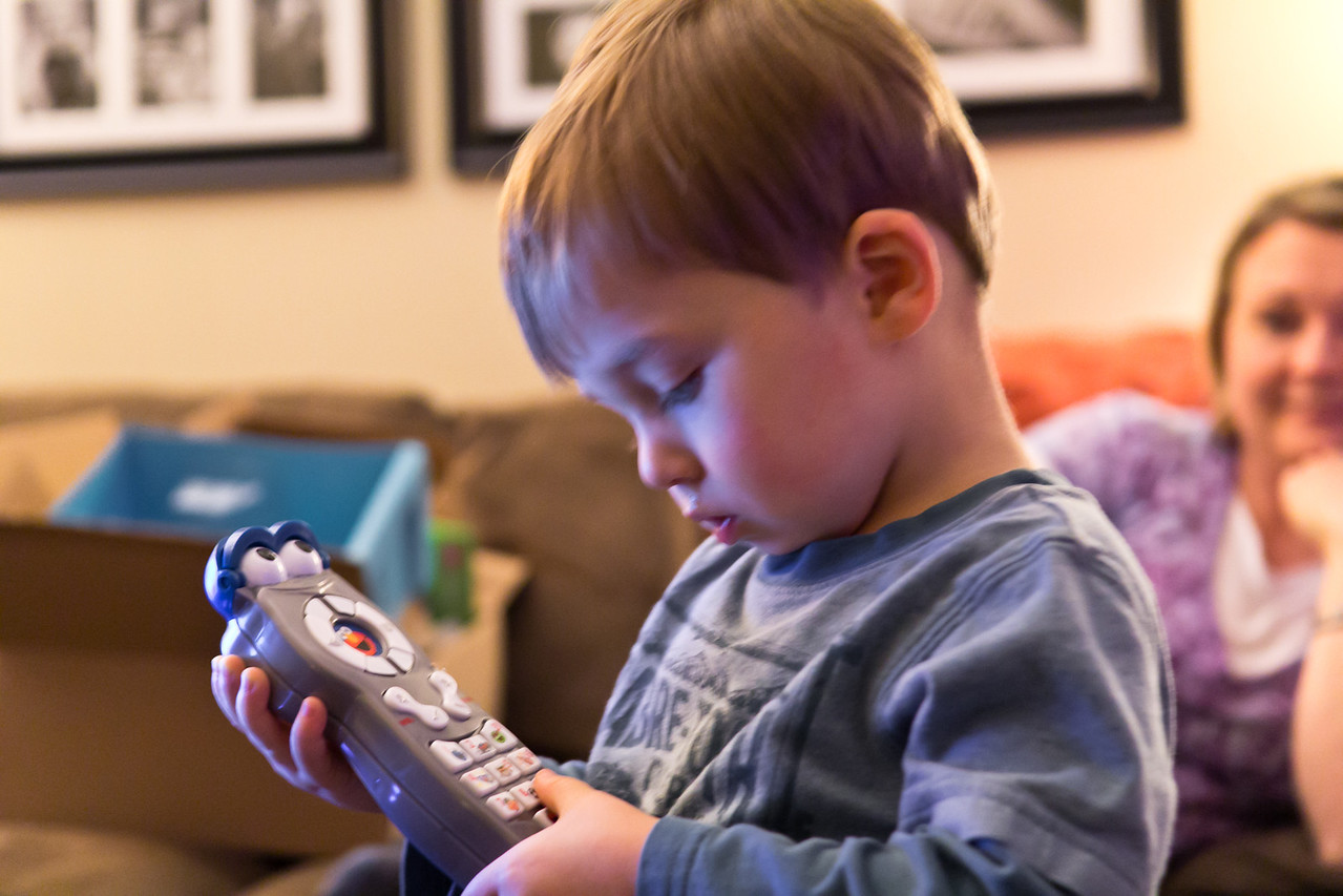 """Cord playing with his """"remote""""."""