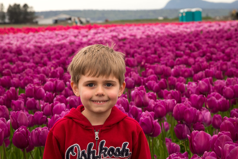 Zach LOVED posing with all the flowers