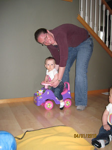 Fiona is trying out the big girl push car