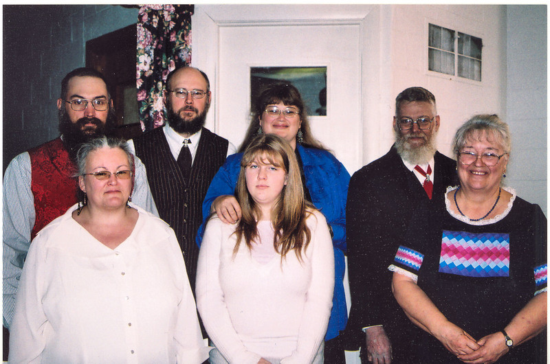 Robin Tucker Family 12-23-06<br /> On the left is my son, Mark with his wife, Clara in front of him. Next to Mark is my Son-in Law, Galen Mommens, with my little 6 Ft 1 1/2 inch daughter, Deborah, beside him. Marks daughter, Kali, is in front of Debbie. Then, there I am with my loverly wife, Kathy, in front of me.<br /> This was at Moms funeral.