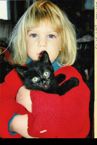 Kali and Dragon, Oct. 1993<br /> My Grand Daughter, Kali, holding my younger brothers cat, Dragon.