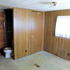 This is the Back Bedroom<br /> The floor is gone in the closet there and had some spongy spots along the back wall that will be fixed.