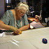 Cutting Out the Satin Dress.<br /> Kathy likes to use the rotary cutter in cutting out the fabric.