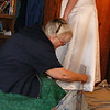 Finishing Checking On the Hem.<br /> For pinning up the hem. It was easier for Kathy to have her stand on a round stepstool so the dress would hang down around it. And also so she would be up higher than down on the floor.