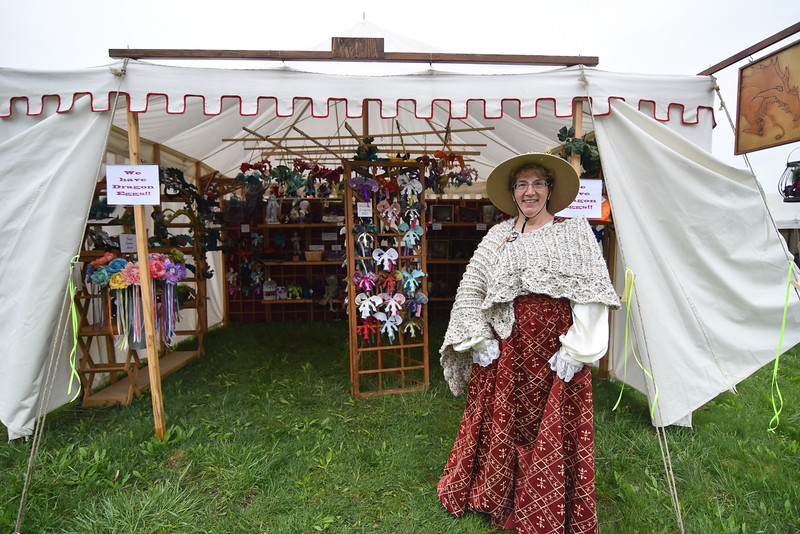 Katherine Pilipauskas of Soft Sculpture poses for a photo in front of her tent at Robin Hoods Faire in Lancaster on Saturday.  SENTINEL & ENTERPRISE JEFF PORTER