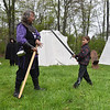 Daytime Knight School instructor Sir Douglas Yeager (left) teaches Ryder Jamieson, 8, of Lancaster how to spar at Robin Hoods Faire in Lancaster on Saturday.  SENTINEL & ENTERPRISE JEFF PORTER