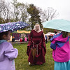 The Queen speaks with sisters Katlyn Merrill, 5 (left), and Elizabeth Merrill, 7, of Lancaster at Robin Hoods Faire in Lancaster on Saturday.  SENTINEL & ENTERPRISE JEFF PORTER