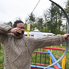 Jason Pryor of H.S.E. gives archery a try at Robin Hoods Faire in Lancaster on Saturday.  SENTINEL & ENTERPRISE JEFF PORTER