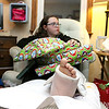 "Dave Mansfield and Rob Ollivierra are making Christmas brighter for a few local families by helping them out with furniture, cleaning out their homes, delivering toys, and more. It's their ""Christmas Miracle."" McKenna boisvert, 11, had her broken leg up and all her Christmas gifts in her lap at her home on Thursday night. SUN/JOHN LOVE"