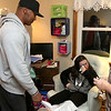 "Dave Mansfield and Rob Ollivierra are making Christmas brighter for a few local families by helping them out with furniture, cleaning out their homes, delivering toys, and more. It's their ""Christmas Miracle."" McKenna Boisvert, 11, was over come with emotion as they brought Christmas gifts to her and her family. Standing ovewr her with some gifts is Robert Ollivierra. SUN/JOHN LOVE"