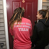 "Dave Mansfield and Rob Ollivierra are making Christmas brighter for a few local families by helping them out with furniture, cleaning out their homes, delivering toys, and more. It's their ""Christmas Miracle."" Lilly Baker Ollivierra of Boston and Vanessa Opland, 12, of Chelmsford ring the bell of of one of the recipients of Christmas gifts on Thursday night. SUN/JOHN LOVE"