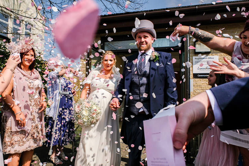 Bride and Groom with confetti.