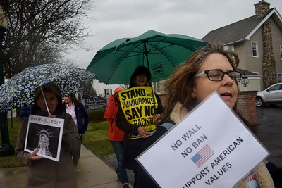 About 40 people joined North Oakland Indivisible for a protest against Trump's budget and immigration policies outside of Sen. Gary Peters office, 407 Sixth St. in Rochester on Monday, April 3, 2017.