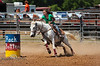 Rounding the Barrels in the Rock Bottom Barrel Races - Photo by Pat Bonish
