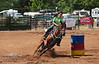 Leaning into that Last Barrel - Rock Bottom Barrel Racing - Photo by Pat Bonish