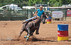 Kicking Up Dirt while Barrel Racing at Rock Bottom - Photo by Pat Bonish